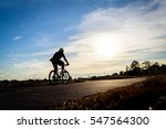 silhouette  man riding bike at... | Shutterstock . vector #547564300