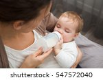 adorable baby with a milk... | Shutterstock . vector #547572040