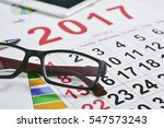 closeup of a pair of eyeglasses ... | Shutterstock . vector #547573243