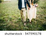 bride and groom walking on the... | Shutterstock . vector #547590178