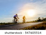 men ride  bicycle at sun set ... | Shutterstock . vector #547605514