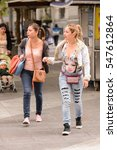 Small photo of SANTIAGO, CHILE - NOV 1, 2014: Unidentified Chilean girli friends walk in Santiago. Chilean people are mainly of mixed Spanish and Amerindian descent