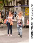 Small photo of SANTIAGO, CHILE - NOV 1, 2014: Unidentified Chilean girls friends walk in Santiago. Chilean people are mainly of mixed Spanish and Amerindian descent