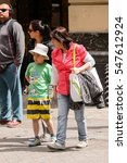 Small photo of SANTIAGO, CHILE - NOV 1, 2014: Unidentified Chilean family walks in Santiago. Chilean people are mainly of mixed Spanish and Amerindian descent