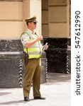 Small photo of SANTIAGO, CHILE - NOV 1, 2014: Unidentified policeman in the street in Santiago. Chilean people are mainly of mixed Spanish and Amerindian descent