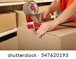 female hands packing box at... | Shutterstock . vector #547620193