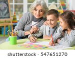 grandmother with kids drawing   Shutterstock . vector #547651270