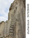 Small photo of Ladder leaning against a rock