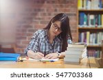 female student writing notes at ... | Shutterstock . vector #547703368