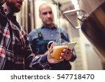 owner pouring beer in glass... | Shutterstock . vector #547718470