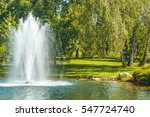the fountain on the lake in the ... | Shutterstock . vector #547724740