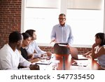 mature businessman addressing... | Shutterstock . vector #547735450