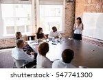 businesswoman at whiteboard... | Shutterstock . vector #547741300
