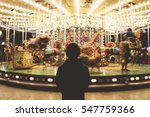 Child Looking At The Carousel