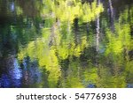 Colorful rippled reflection on water - stock photo