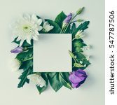 Stock photo creative layout made of flowers and leaves with paper card note flat lay nature concept 547787506