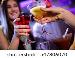 friends toasting cocktail at... | Shutterstock . vector #547806070