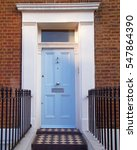 Small photo of Notting hill, London, colorful entrance light blue door
