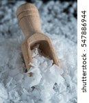 salt flakes and wooden scoop on ...   Shutterstock . vector #547886944