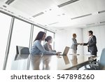 businesspeople shaking hands in ... | Shutterstock . vector #547898260