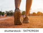 sports runner feet on road  ... | Shutterstock . vector #547929034