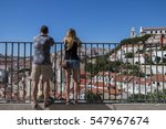 a couple of tourists gazing... | Shutterstock . vector #547967674