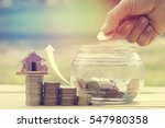 hand put money coins in glass... | Shutterstock . vector #547980358