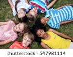children lying on grass with... | Shutterstock . vector #547981114