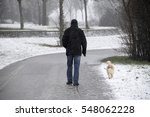 walking the dog in the winter | Shutterstock . vector #548062228