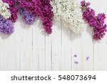 the beautiful lilac on a wooden ... | Shutterstock . vector #548073694