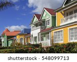 The Wooden Houses Painted In...