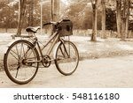 a vintage bike stand on road in ... | Shutterstock . vector #548116180