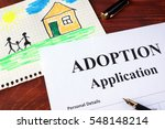 Small photo of Adoption form and childrenâ??s picture. (I am owner of picture.)