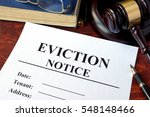 eviction notice and gavel on a... | Shutterstock . vector #548148466