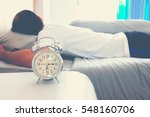 alarm clock with a man sleeping ... | Shutterstock . vector #548160706