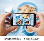 taking photo of one's breakfast ... | Shutterstock . vector #548163334