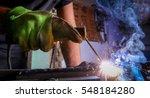 worker welding the iron | Shutterstock . vector #548184280