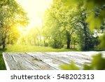 wooden table in garden of... | Shutterstock . vector #548202313