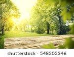 wooden table in garden of... | Shutterstock . vector #548202346