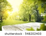 wooden table in garden of... | Shutterstock . vector #548202403