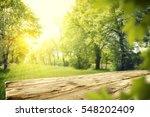 wooden table in garden of... | Shutterstock . vector #548202409