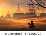 silhouettes muslim prayer the... | Shutterstock . vector #548205724
