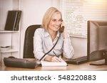cute businesswoman on phone... | Shutterstock . vector #548220883