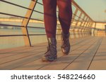woman walking on a wooden... | Shutterstock . vector #548224660