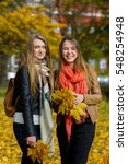Two Girls With Bouquets Of...