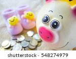 Piggy Bank With Coin And Baby...