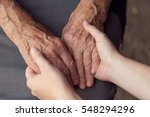 Stock photo old and young person holding hands elderly care and respect selective focus 548294296