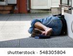 Homeless Man Sleeps On The...