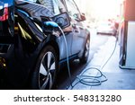 Charging modern electric car on the street which are the future of the Automobile