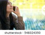 a beautiful asian woman talking ...   Shutterstock . vector #548324350